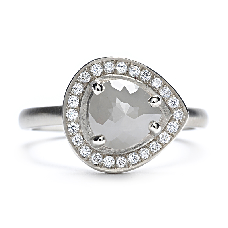 A rose-cut center diamond is surrounded by round, brilliant pave diamonds in this handcrafted ring that combines modern glamour with natural inspirations.  at Greenwich Jewelers