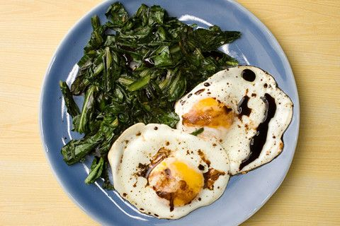 Wilted greens with balsamic fried eggs. By Aida Mollenkamp for Chow.com  (Ed. Pity Chow.com took such a gross picture for a deceivingly simple and sophisticated breakfast. I suggest the addition of roasted tomatoes and basil to up the flavor notch.)