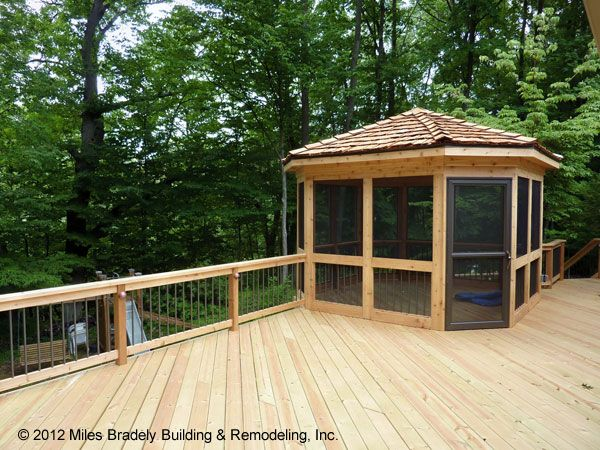 This is a custom built deck with a screen enclosure gazebo for Deck with gazebo