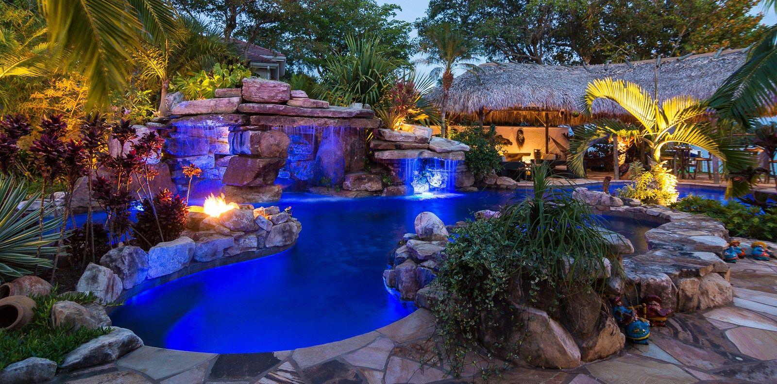 Natural Rock Waterfall Pool Siesta Key Custom Pools With Tiki Hut Custom Pools Amazing Swimming Pools Dream Backyard Pool