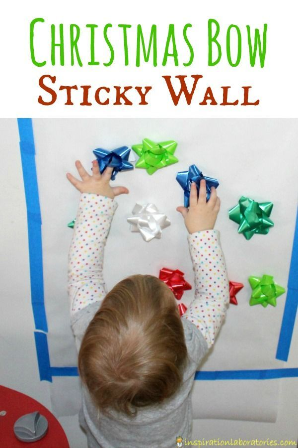 Bow Sticky Wall A Christmas bow sticky wall is the perfect activity for toddlers. Practice fine motor skills, colors, patterns, and keep them entertained!A Christmas bow sticky wall is the perfect activity for toddlers. Practice fine motor skills, colors, patterns, and keep them entertained!