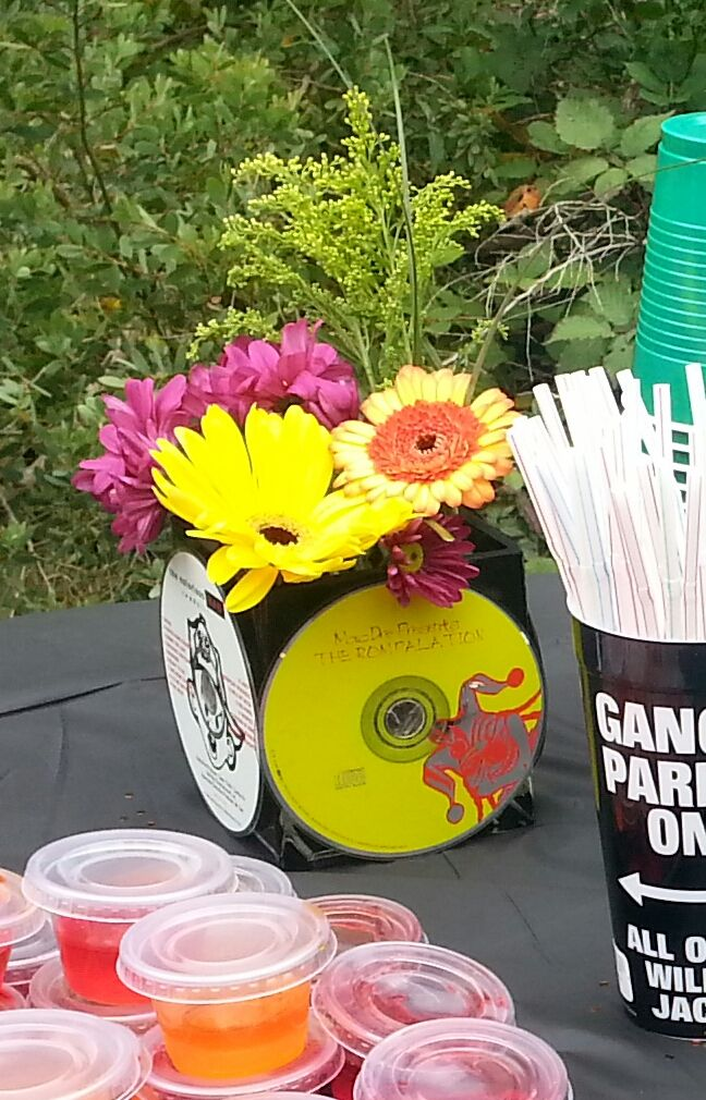 Made with small vases and old CD's for a 90's hip hop themed birthday bbq in the park.