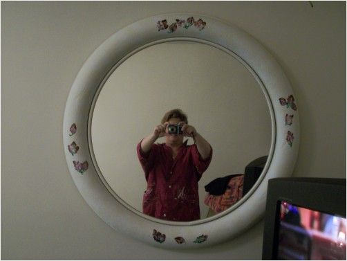 Old mirror that was beat up and ugly. I cleaned it up, sponge painted it and added a few decals. Now its on my wall.