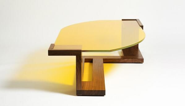 The Lemon Tree Coffee Table. Handcrafted from solid American Black Walnut, and with a bold, asymmetric yellow fused glass top. Available exclusively in The Clerkenwell Collection in London, as part of a Limited Edition Collection. #design #woodwork #interior #home