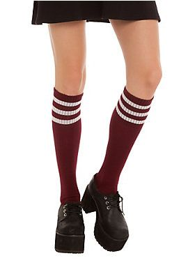Burgundy knee-high crew socks with three white stripes at the top.<ul><li> One size fits most</li><li>75% acrylic; 25% spandex</li><li>Wash cold; dry low</li><li>Imported</li></ul>