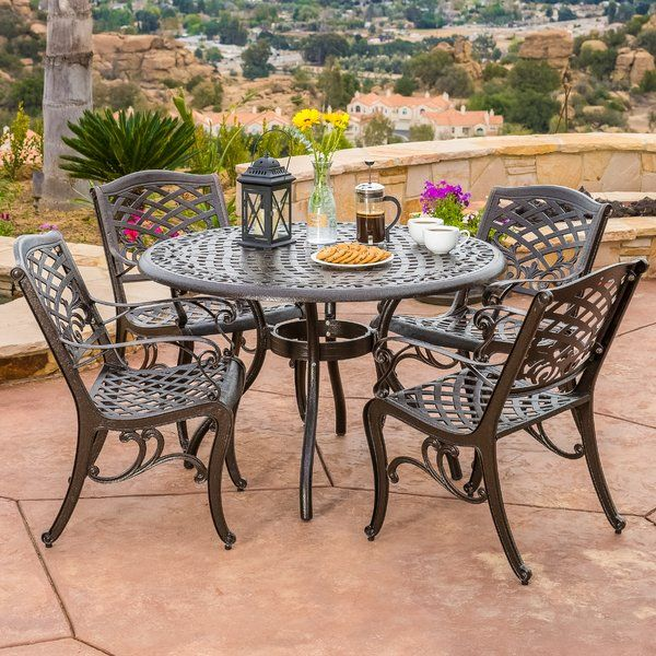 The Harrelson 5 piece dining set is a beautiful addition for your outdoor decor. Made from cast aluminum, the set includes four dining chairs and one mesh table. The features include a mesh back and seat rest and the table also features a patio umbrella opening. The antique bronze finish is neutral to match any outdoor furniture and will hold up in any weather condition. Whether in your backyard, patio, or deck, you'll enjoy this set for years to come.