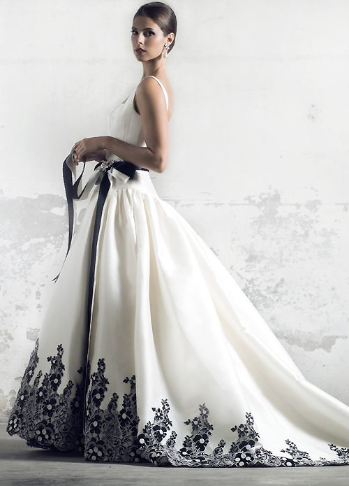 fc731bd96fc Long white ballgown with black trim at hem. Elegant.