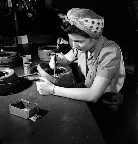 Female worker Ella Meilke working on a compass at the Ontario Hughes Owen Company Ltd. Ottawa plant. (item 1)