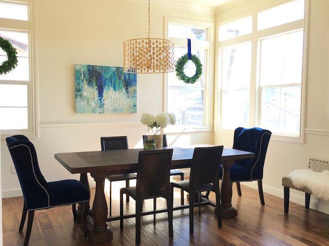 Eggshell Home Modern Glam Dining Room Blue Velvet Chairs Gold Chandelier