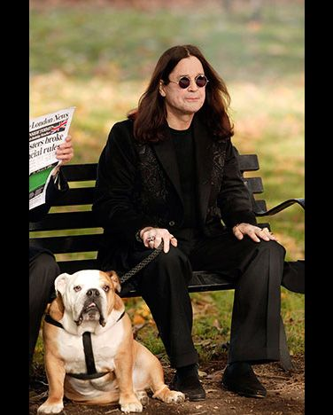 Ozzy Osbourne takes a rest from filming a music video with Lola, his English Bulldog.