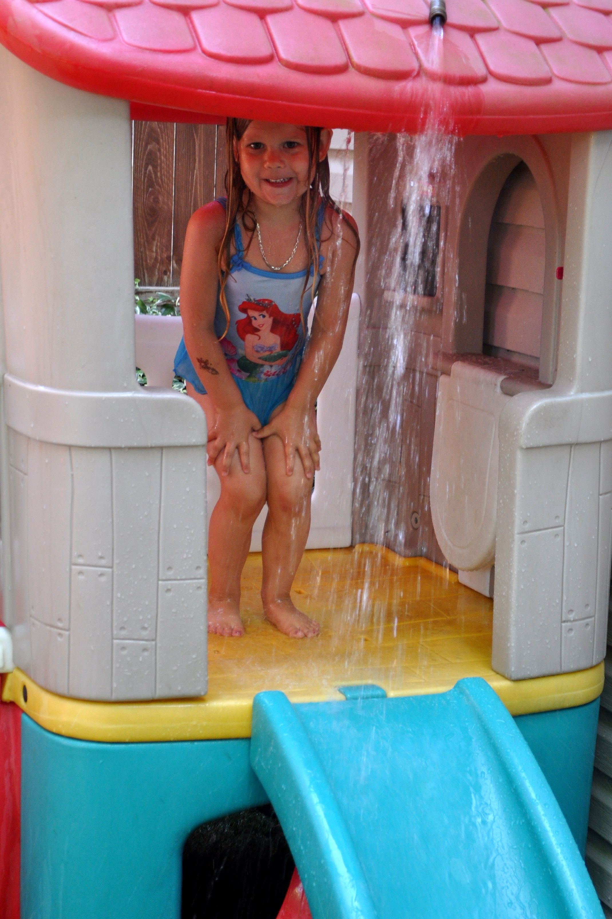 homemade splash pad hook the hose to the top of your backyard