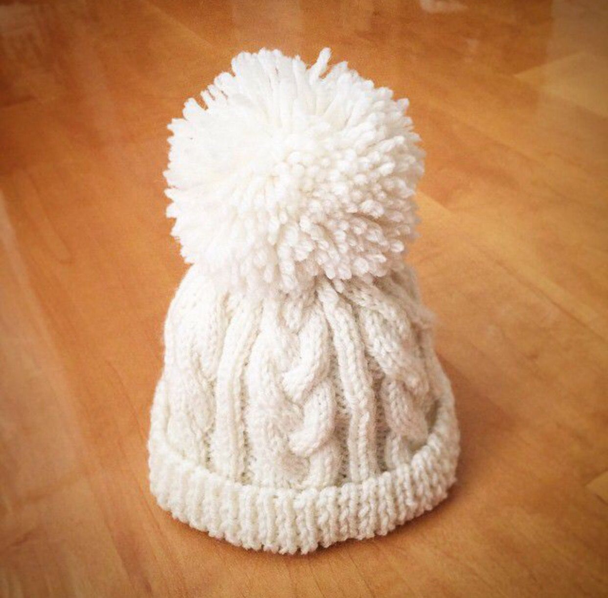Hand knitted kids white wool beanie - Cable stitch pattern with pompoms