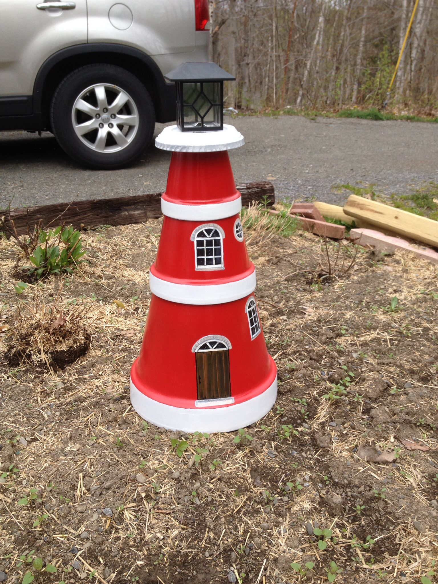 lighthouse from clay pots the top is a solar light. Black Bedroom Furniture Sets. Home Design Ideas