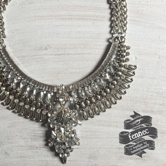 Structured Silver Double Chain Statement Necklace Beautiful, heavy statement necklace. Double chain link necklace connected to decorative metal design with a jeweled statement piece in center. The perfect was to add badassery to any ol' outfit. Please ask any questions! No tags on actual item, but it is brand new from manufacturer. fennec Jewelry Necklaces