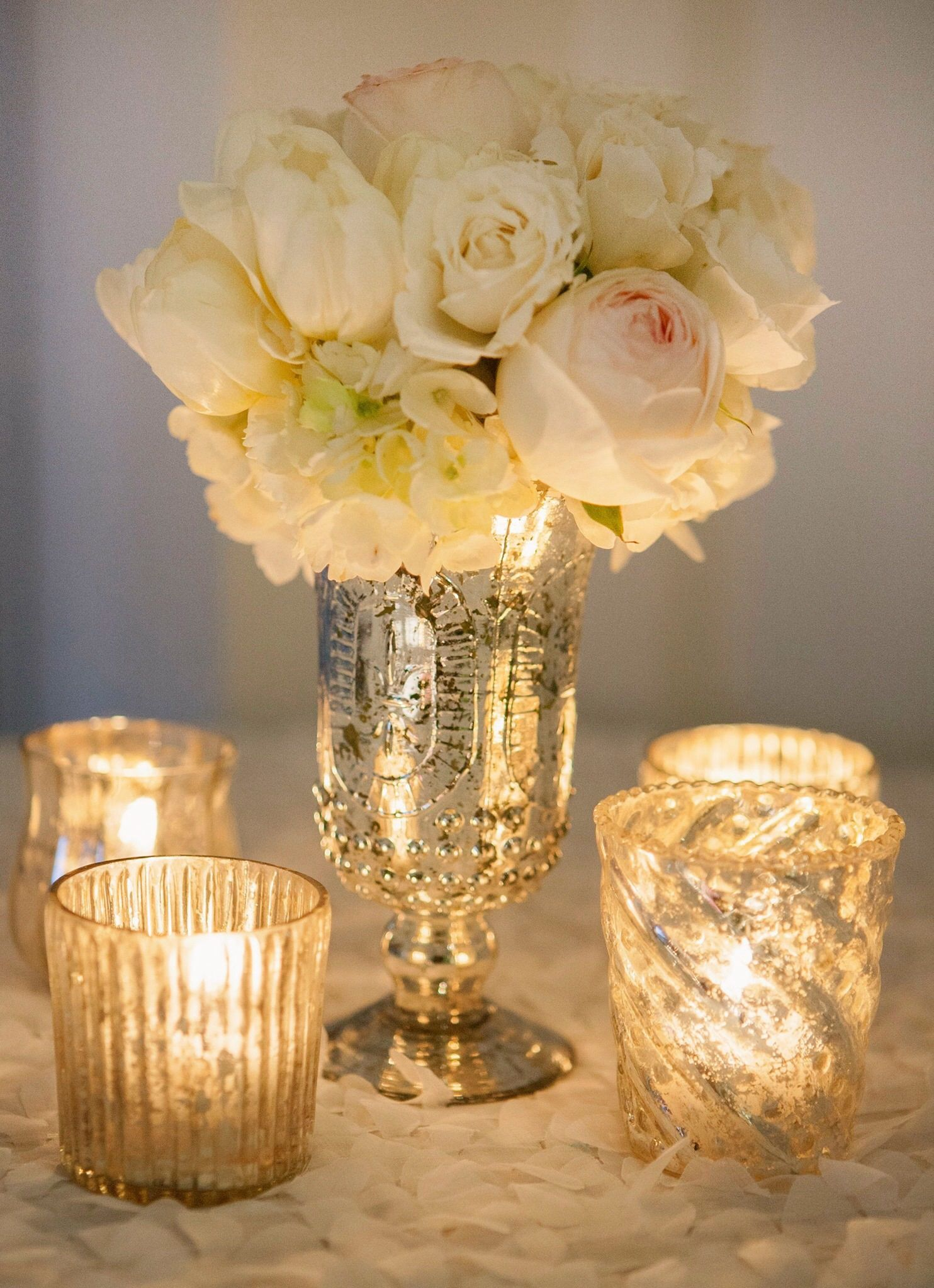 Whimsical Centerpiece With Mismatched And Weathered Texture To Keep