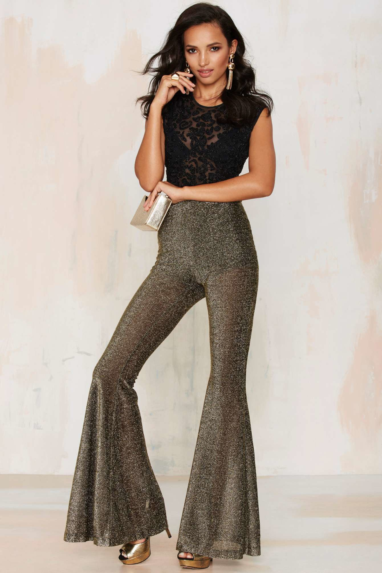https://cdna.lystit.com/photos/cec2-2015/11/10/nasty-gal-flyin-sparks-metallic-flare-pants-product-3-215575206-normal.jpeg