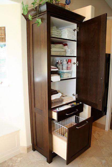 Custom bathroom storage tower with hamper built ins for Small bathroom hamper