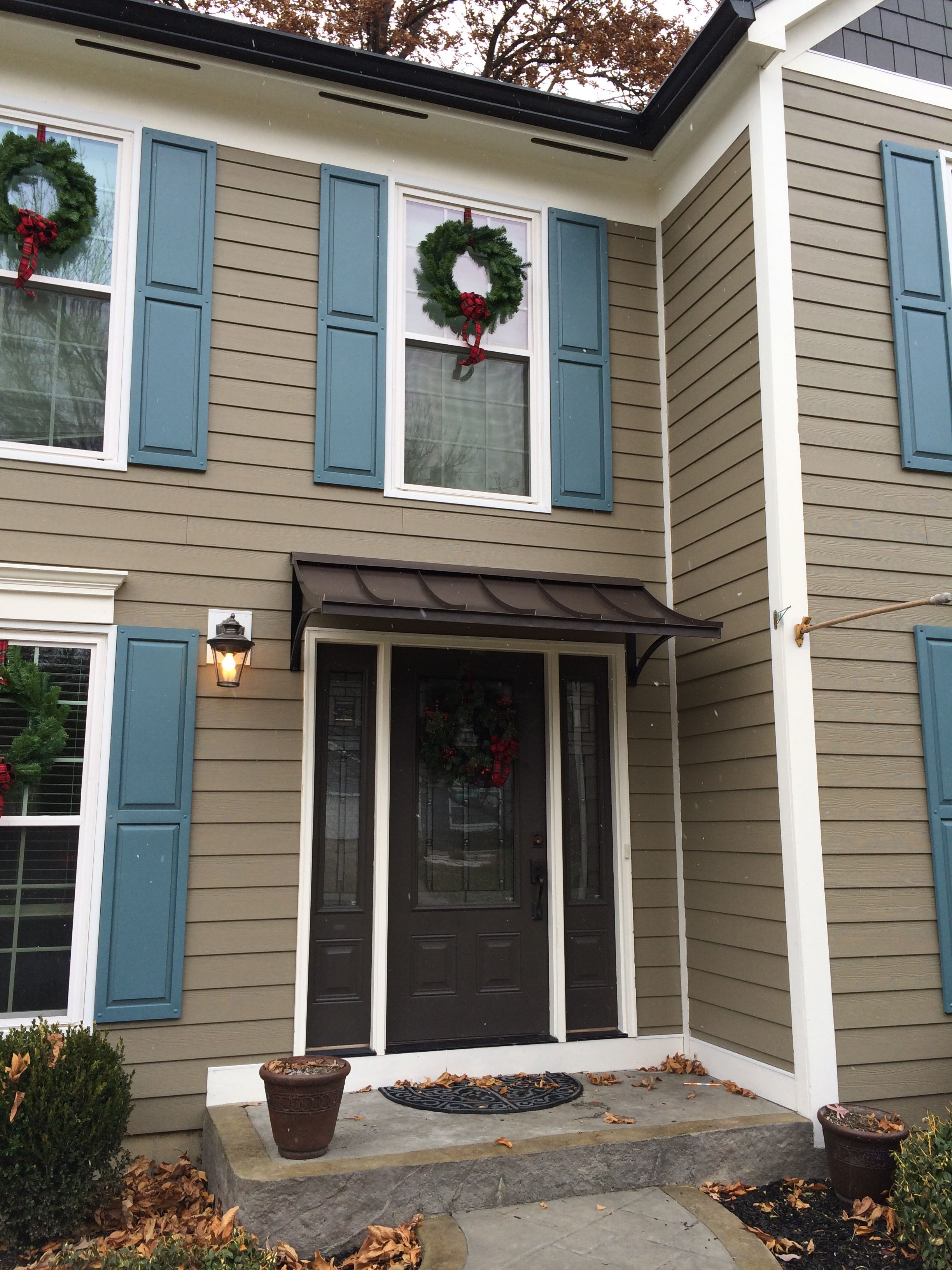 Concave metal door awning in west chester township oh for Metal front doors