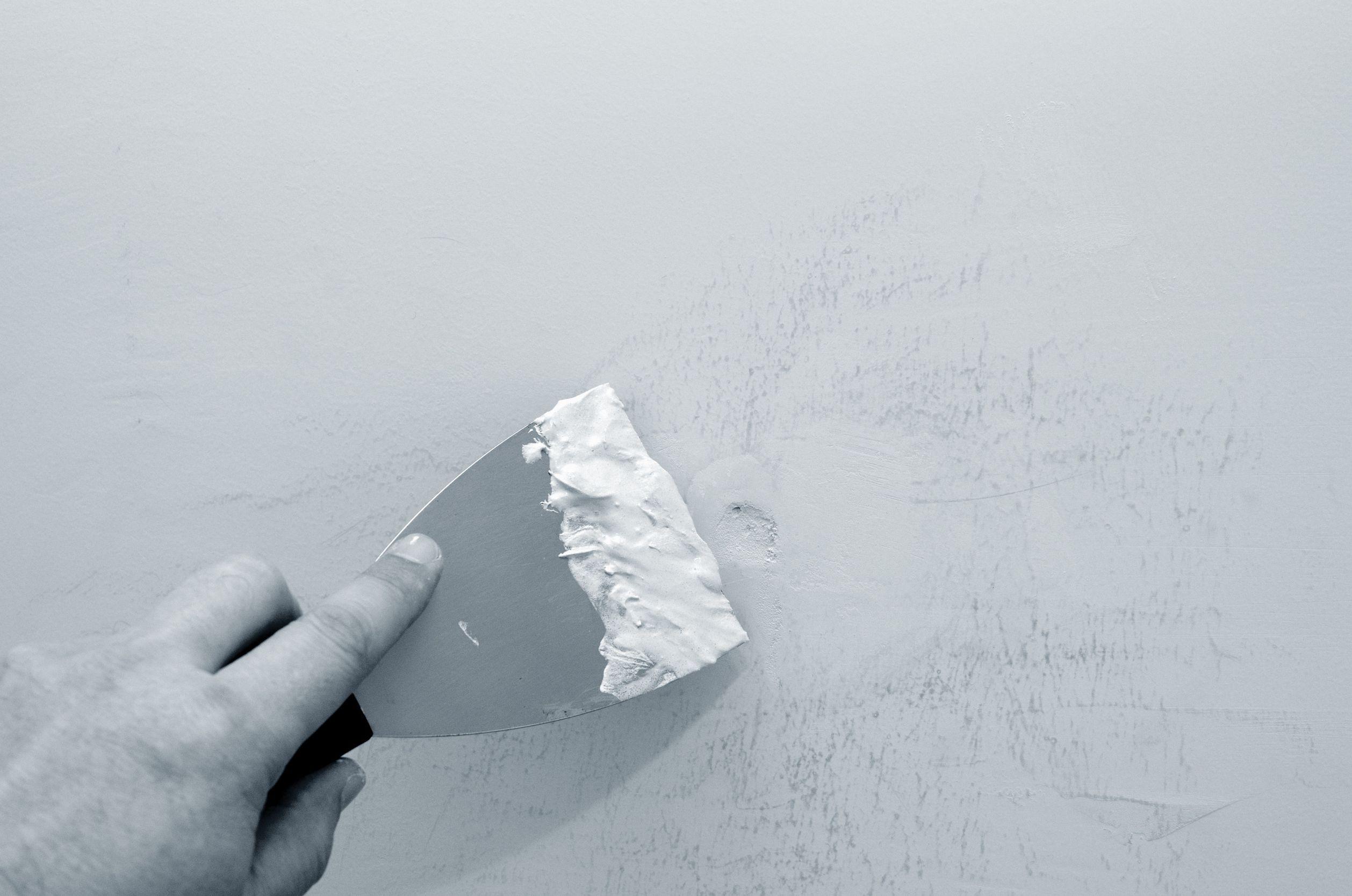 how to repair plaster walls holes
