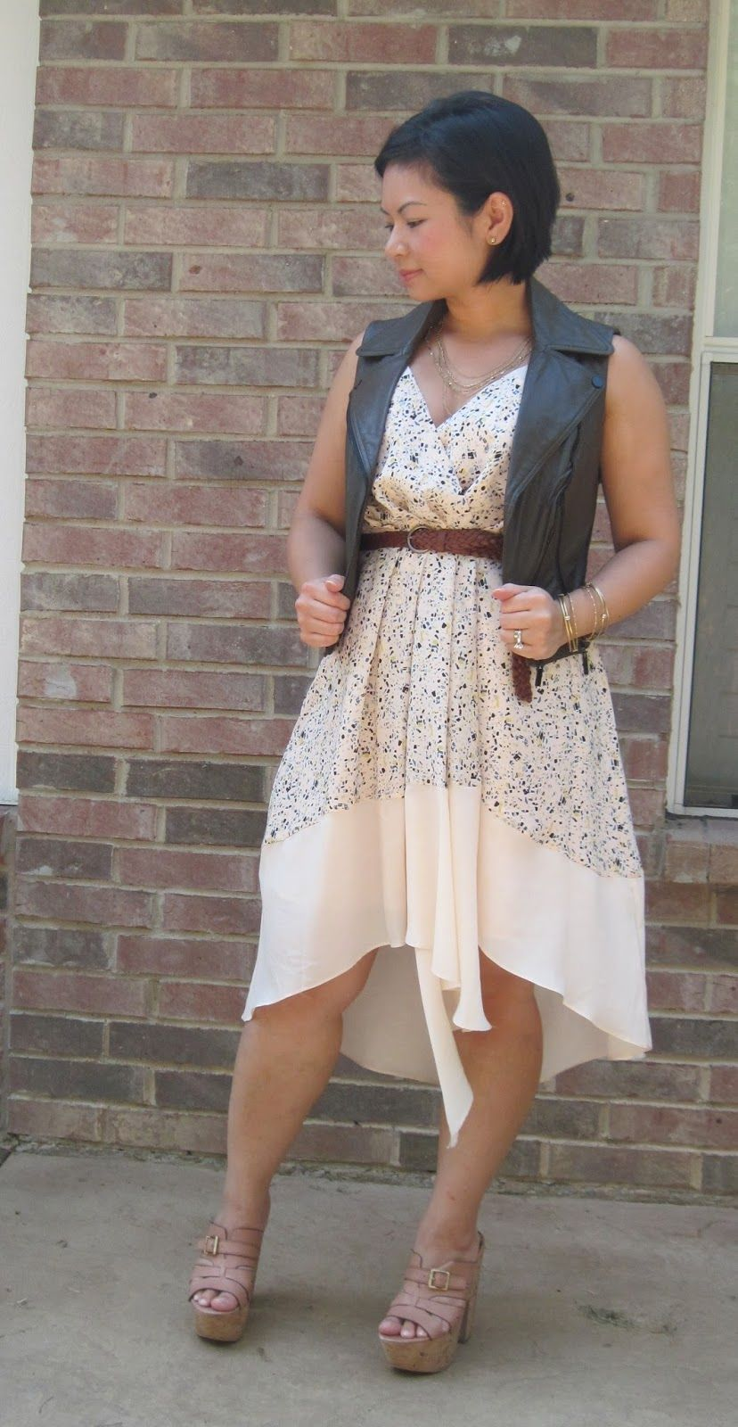 toughen up a girly dress with a leather vest
