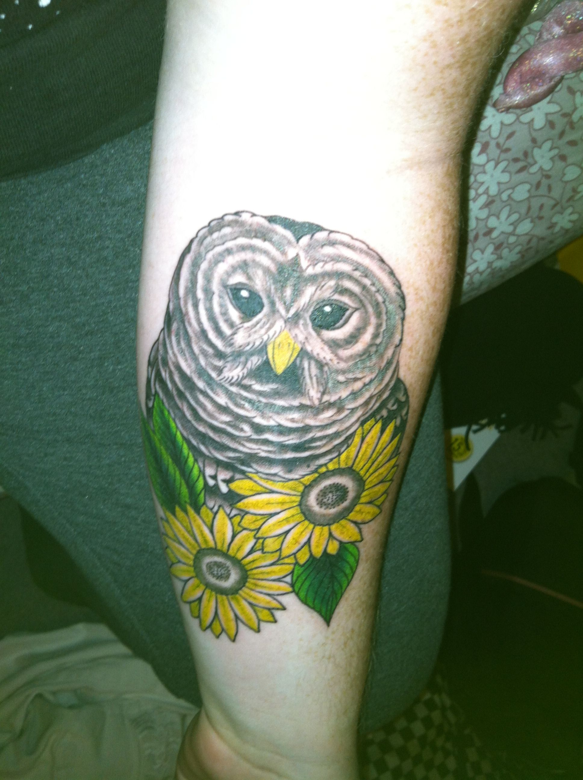 My owl tattoo done by marco at oak city tattoo piercing