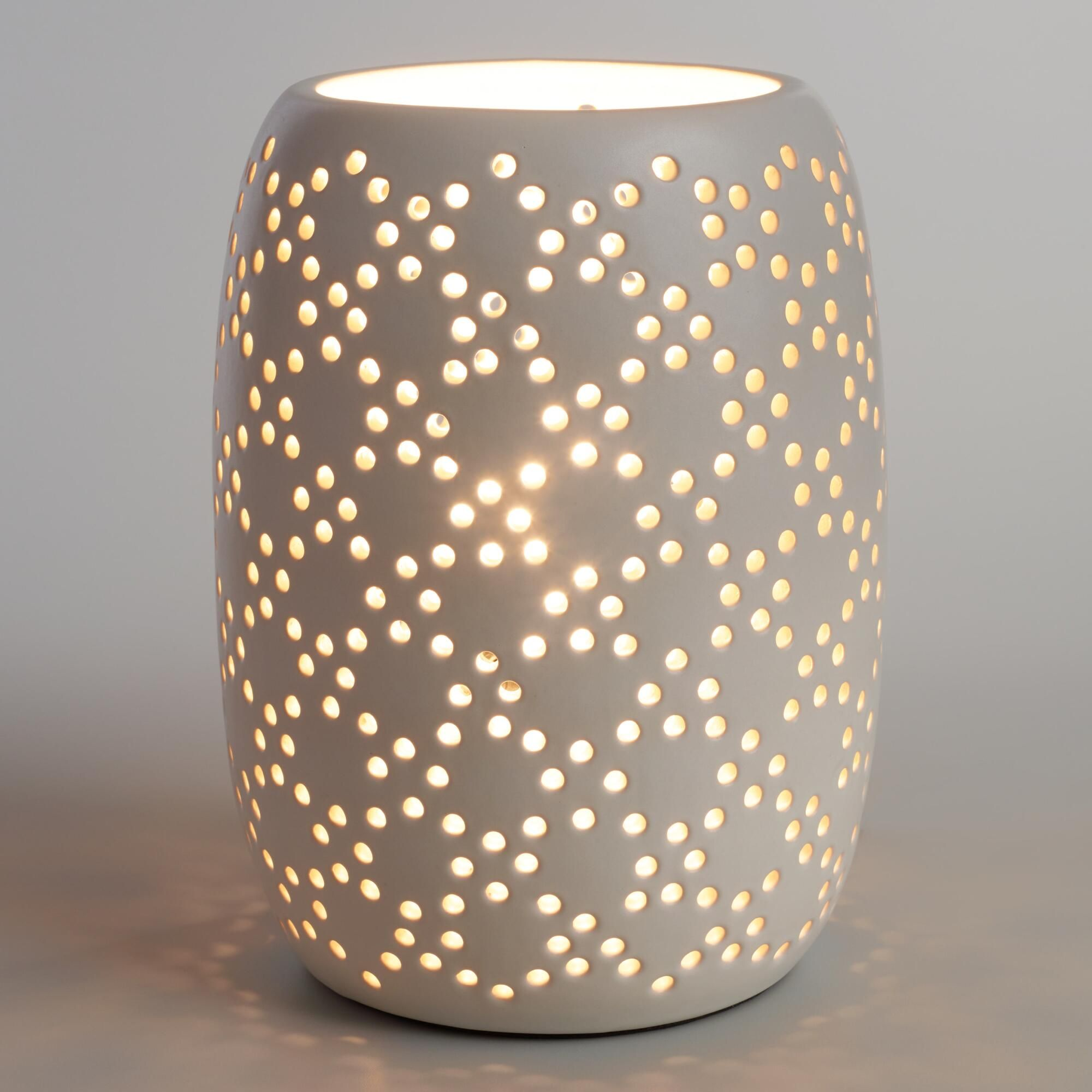 Crafted of white ceramic with a cylindrical silhouette our crafted of white ceramic with a cylindrical silhouette our exclusive table lamp features a perforated mozeypictures Image collections