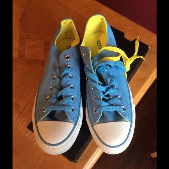 Light blue/yellow converse Light blue converse. Men's SZ6/ women's SZ 8 (unisex). Brand new with box. Converse Shoes Sneakers