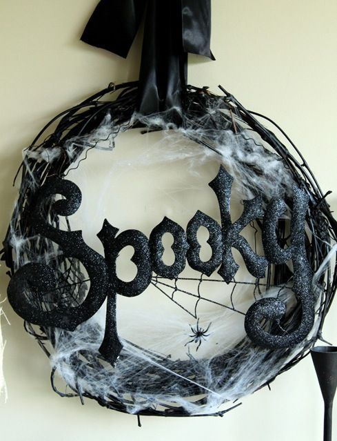 Great Spooky Wreath~ Spray paint a grapevine wreath black, add - spider web decoration for halloween