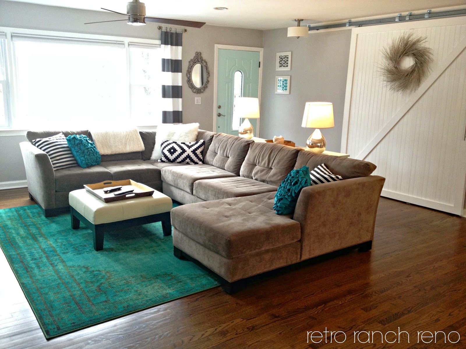 Black And White Living Room With Teal teal rug || living room rug || barn door || aqua || striped