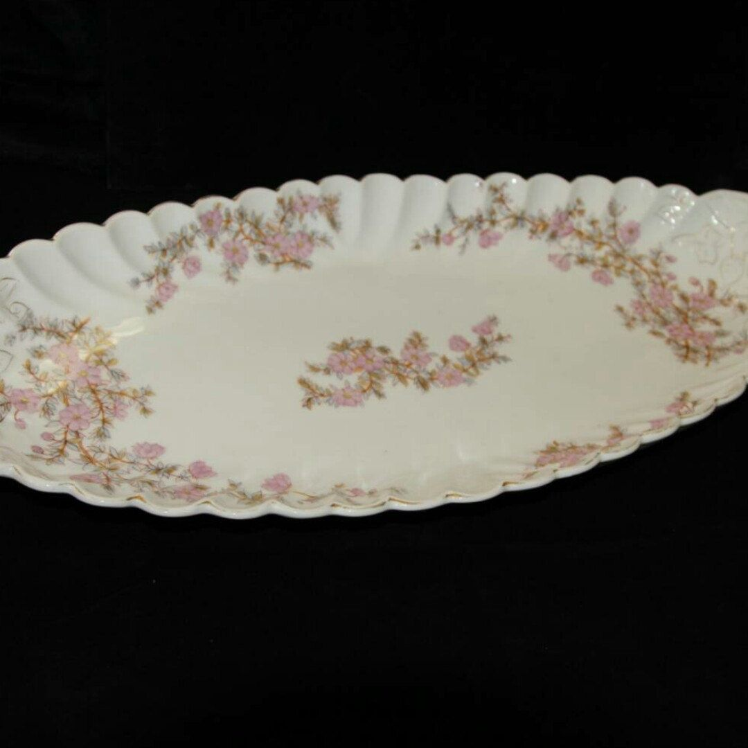 This spectacular vintage dish is beautiful and from the late 1800s. It could be used for everyday use or as a display piece.