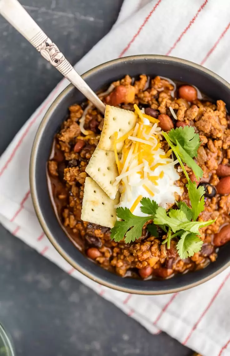 Bowl Of Chili Topped With Crackers Sour Cream And Cheese Best Chili Recipe Best Chili Recipe Ever Chili Recipes
