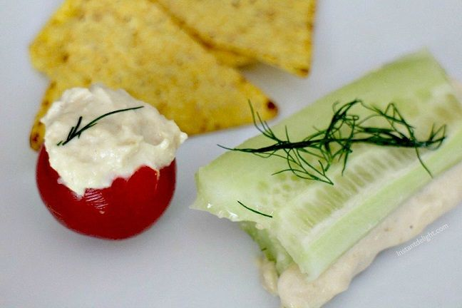 I love the idea of stuffed tomatoes and cucumber sandwiches but I would nix the hummus and mix Earth Balance MindfulMayo with a little lemon, dill, parsley and salt and pepper for a spread. Sounds good!