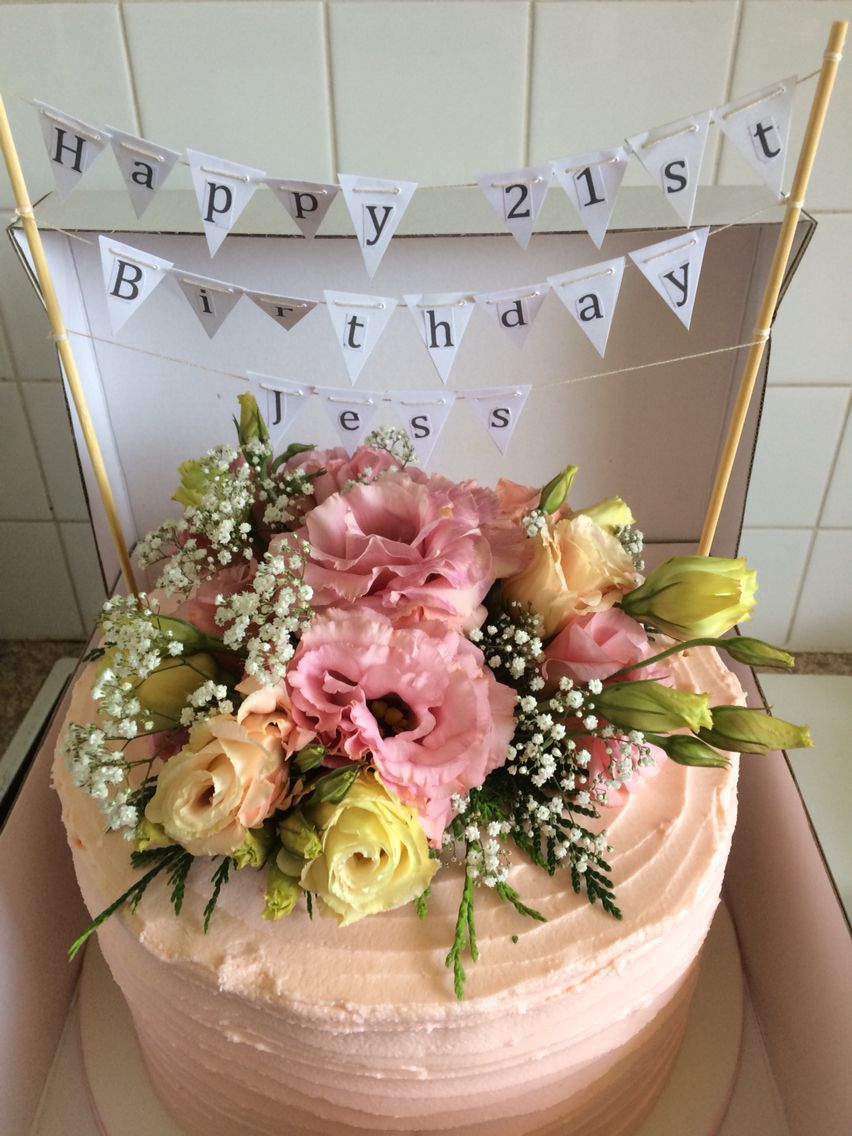 Vanilla Cake With Pale Pink Calling Buttercream And Fresh Flowers