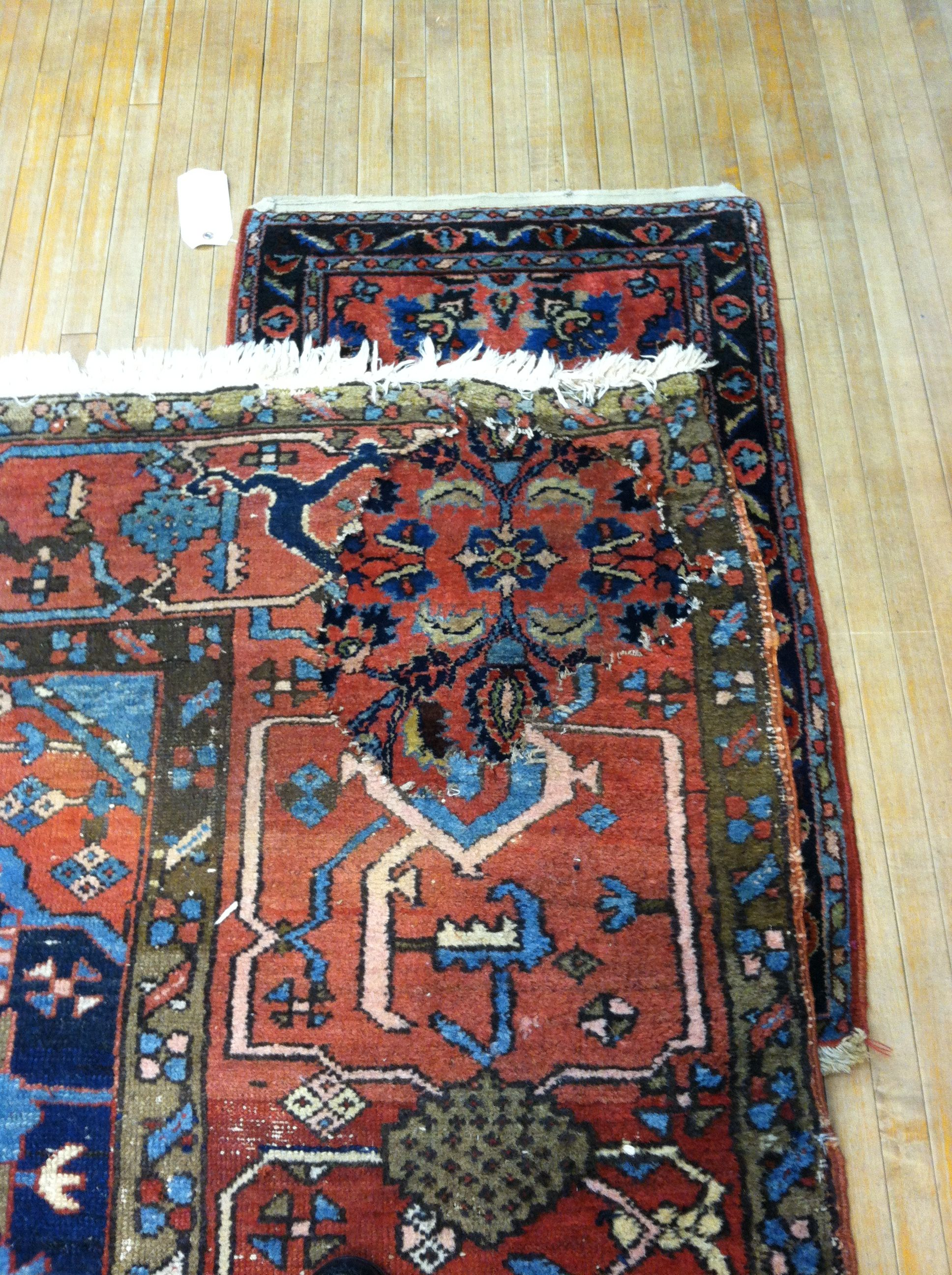A patch is found to fill the hole caused from a potted plant. In this case another small rug will be used to fill the hole. #rugpatch #rugrepair #herizpatchedcorner #rugrestoration #persianrugrepair #rugreweaving #orientalrugrestoration