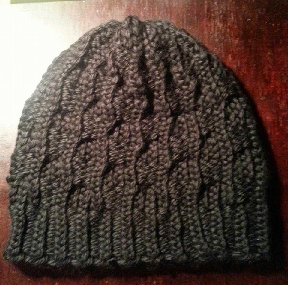 Hubby\'s next hat, maybe? I\'ll use u-wrap, of course! Looming ...