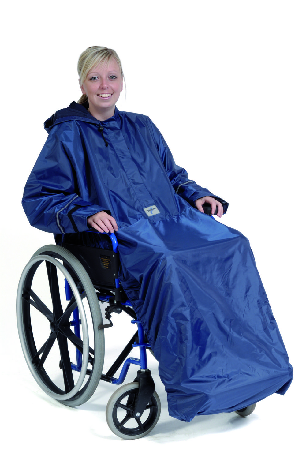 Adults Wheely Mac Sleeved  Ideal clothing protection from the wet weather. The Simplantex Wheely Mac is a handy hooded mac, which secures over the back of the wheelchair taking into consideration the push handles. In addition it secures under the foot plate with an elasticated base.