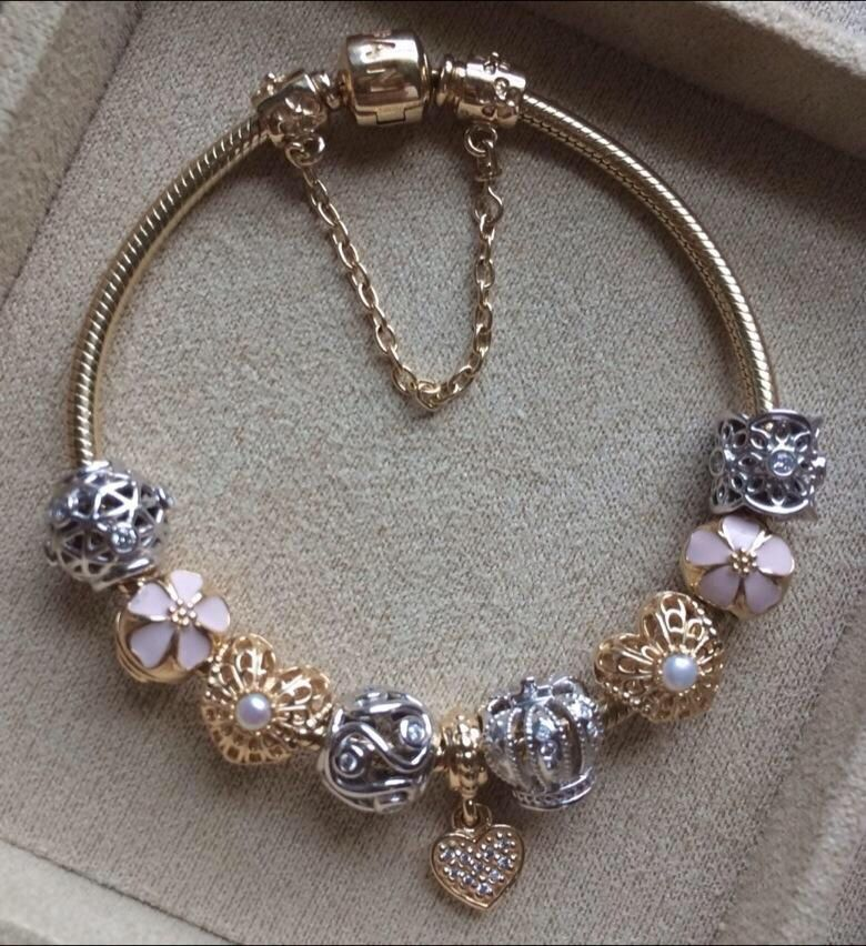 pandora bracelet with stunning gold charms and a touch of