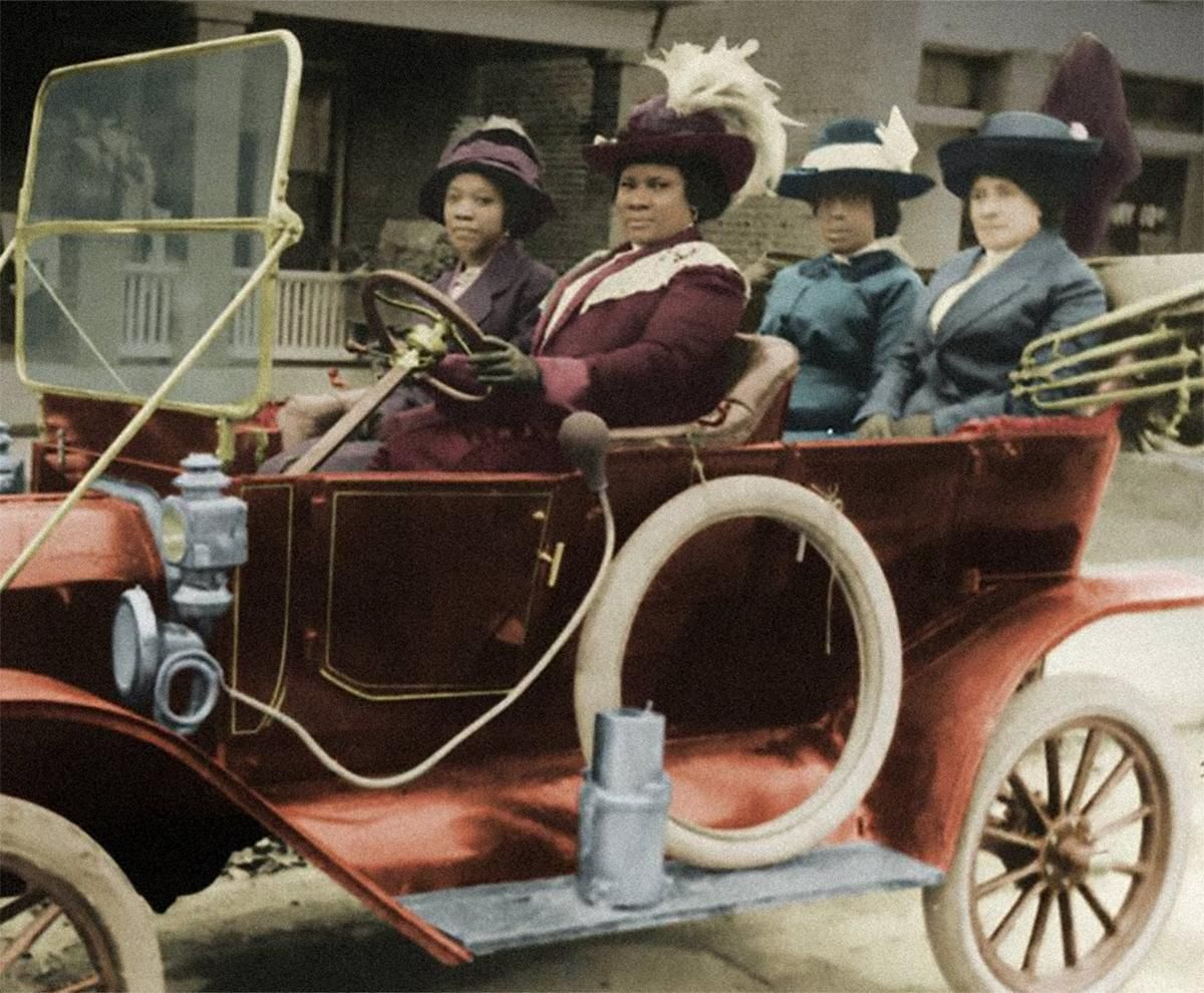 A colorized photo of Madam C. J. Walker with her friends
