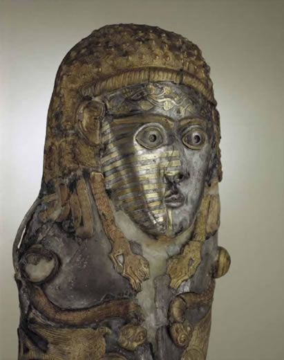"""The silver greave from Vratza with a mask of a snake legged goddess is the best specimen of the entire series of objects from the Thracian """"ceremonial armour"""". It was usually worn only on the left leg, in order to designate the warrior as """"one-legged"""". The silver greave from Vratza"""