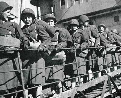 In 1945, when these WACs (Women's Army Corps) shipped out from Britain to France, more than 280,000 women were serving in all branches of the military - the Navy's WAVES, the Coast Guard's SPARS and Women Marines. Their rank and title were the same as the men's; so was the pay. Before the war, only the Army and Navy Nurse Corps admitted women.