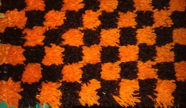 Small latch hook rug made from scraps of wool.