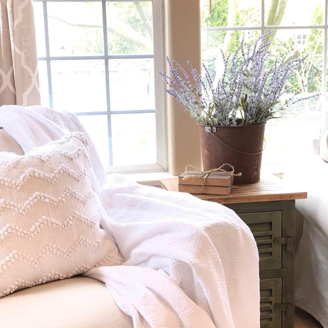 White living room decor / Ikea chair / Rusty bucket Design