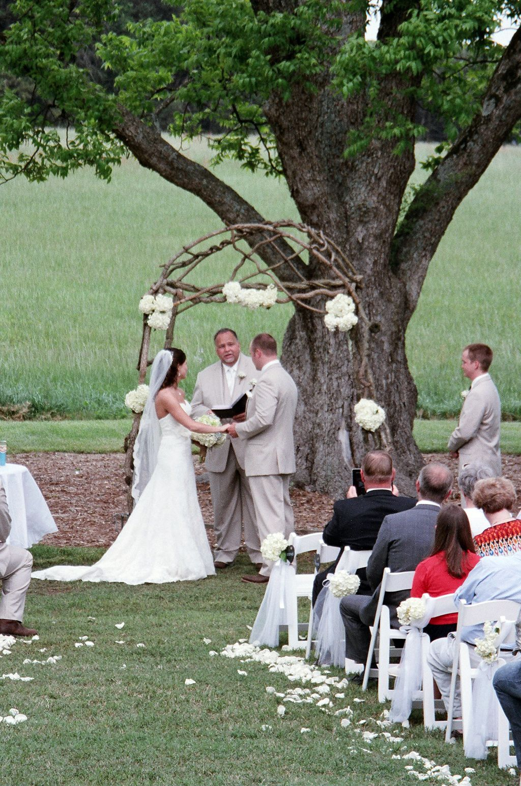 Wedding ceremony under a lovely rustic arbor with hydrangeas at Lenora's Legacy in South Carolina. http://www.lenoraslegacy.com/
