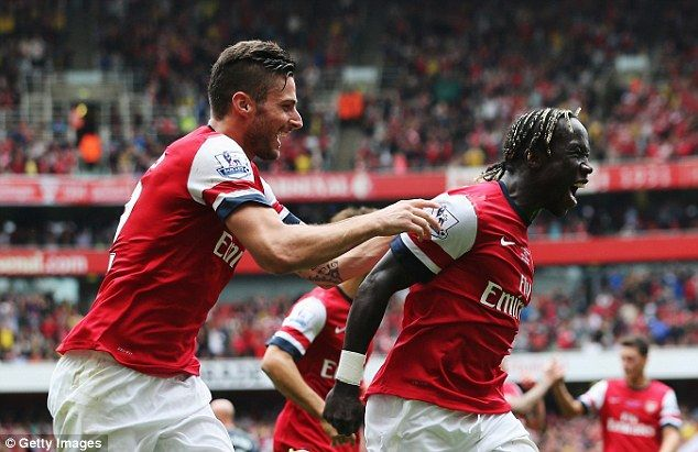Good feeling: Bacary Sagna celebrates with Giroud as he scores Arsenal's third goal