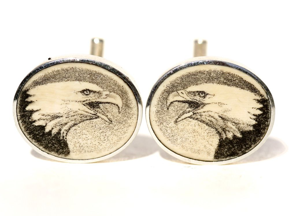 """Handmade sterling silver scrimshaw cufflinks. Handmade scrimshaw cufflinks by Jenkins with scrimshaw by David Smith on ancient mammoth ivory. We do not get many of these cufflinks anymore, but whenever we do they are always first rate. Size: 3/4"""" Diameter Price: $275.00 -- on ScrimshawGallery.com #cufflinks #jewelry #scrimshaw"""