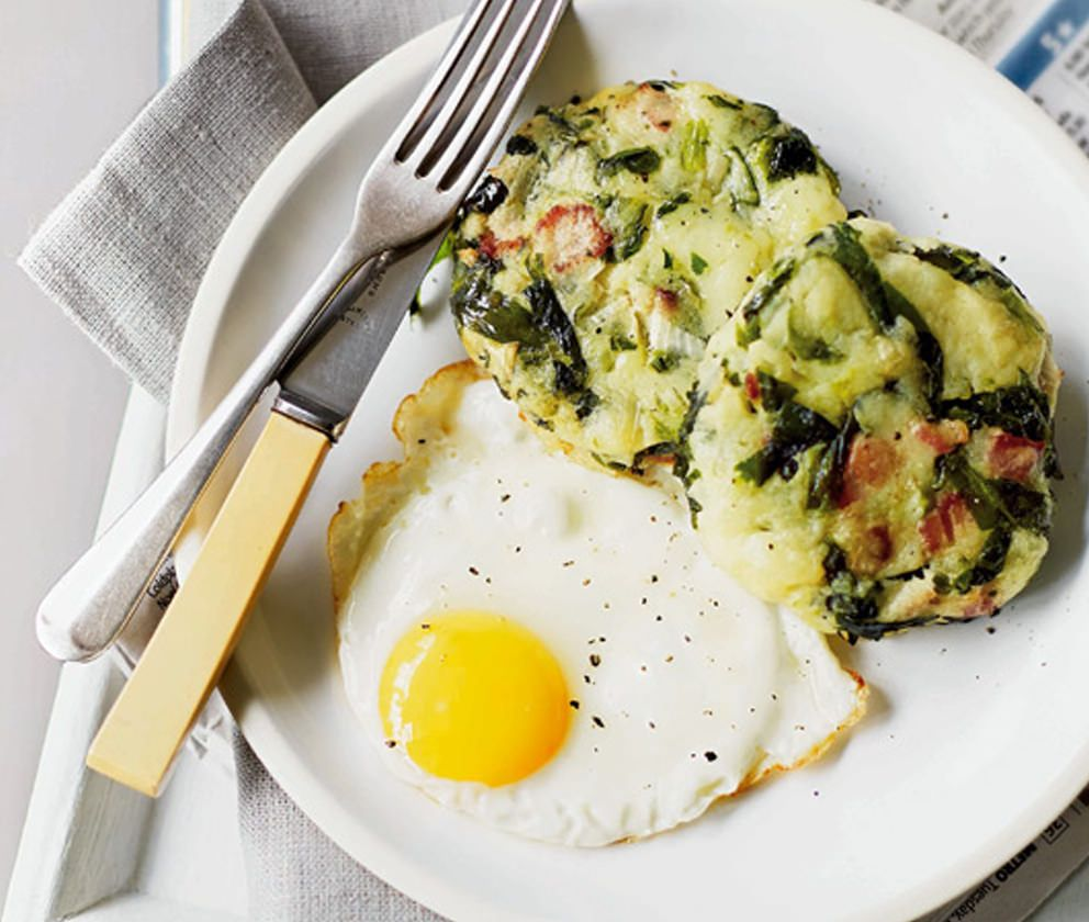 Spring greens and potato shaped into discs with a fried egg