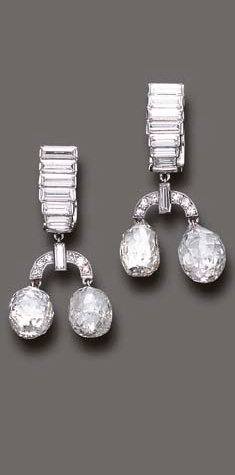 A PAIR OF DIAMOND EAR PENDANTS, BY CARTIER Each designed as a baguette-cut diamond stepped line, suspending a single and baguette-cut diamond link to the twin briolette-cut diamond drops, mounted in platinum, circa 1937 Signed Cartier