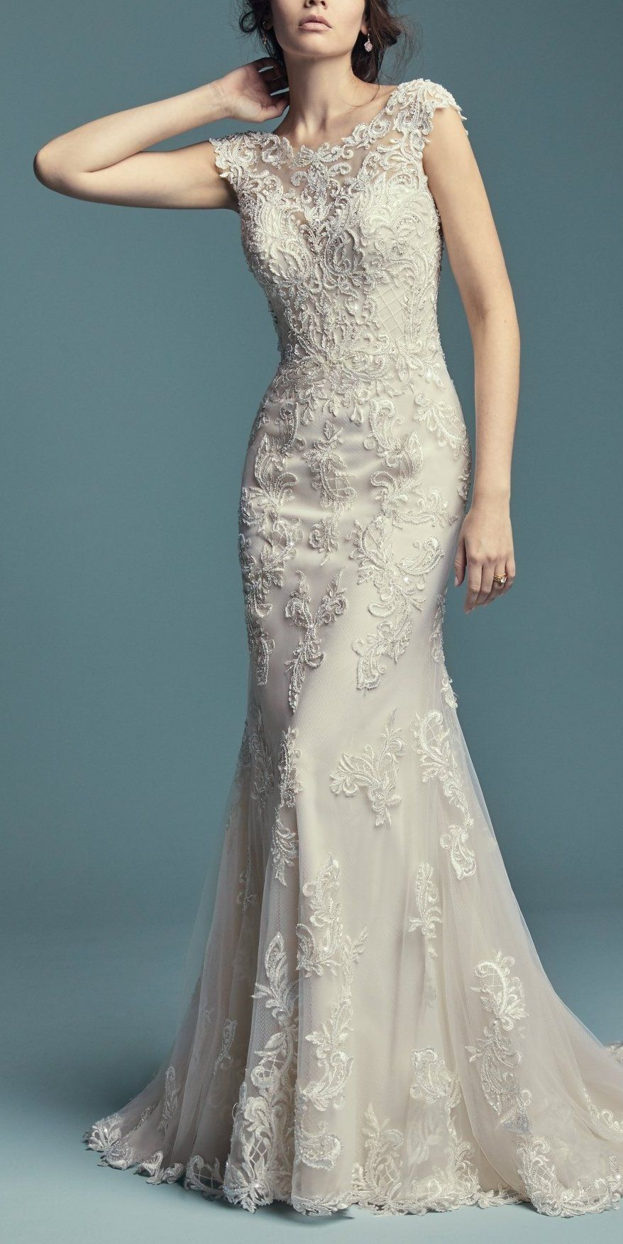 b20edba8 Maggie Sottero - ROSANNA, This lovely sheath wedding gown features beaded  lace motifs accented in Swarovski crystals atop tulle, creating an illusion  bateau ...