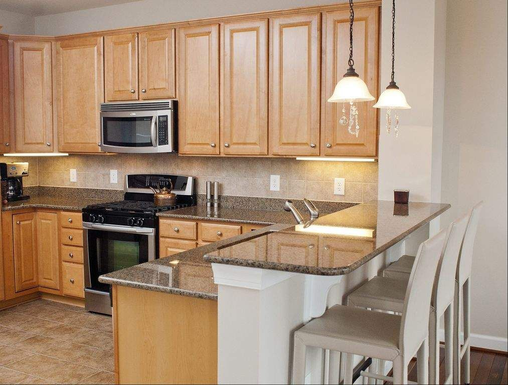 Maple Cabinets And Grey Granite Countertops Kitchens