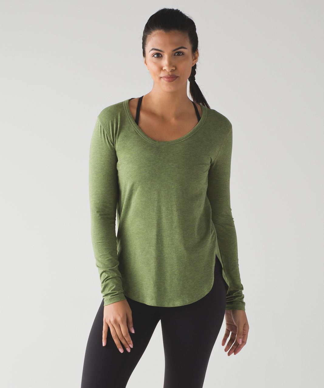 32efcb79d913b Color  heathered brave olive. This super soft long sleeve was designed to  tuck into your tights for a distraction-free practice.